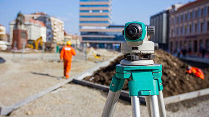 Building site with measuring instrument as main focus