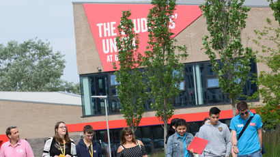 People walking past The Students' Union at UWE building on Frenchay Campus.