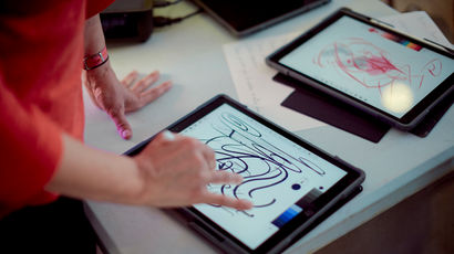 Person using tablet for art