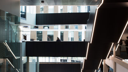 An image of a modern staircase in the Bristol Business School.
