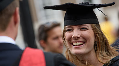 Close up image of a student smiling at graduation
