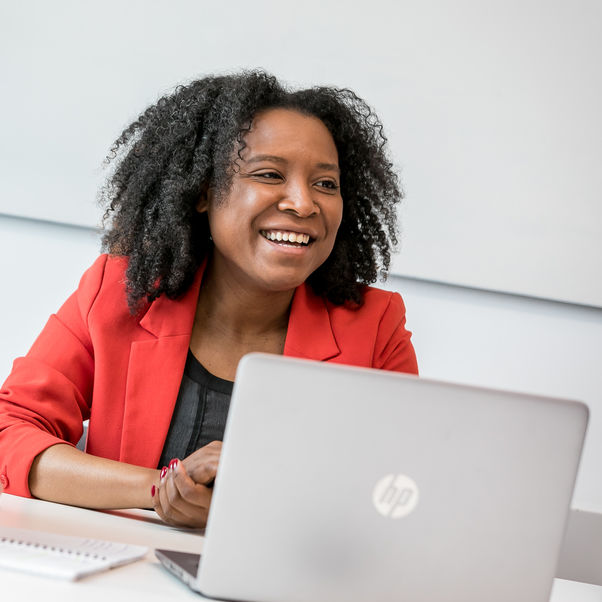 Business woman smiling with laptop