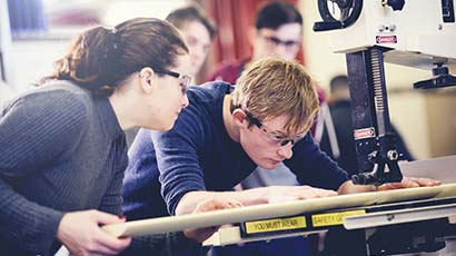 Two students using facilities in the Engineering department