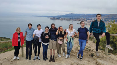 Group of students gathered on a coastal field trip