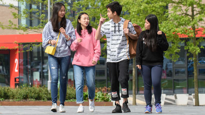 Group of students walking on Frenchay Campus.