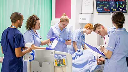 Nursing students monitoring a patient in the Simulation Suites