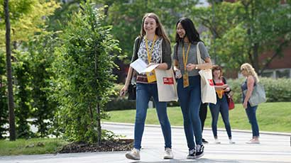 Students walking around campus on an Open Day.