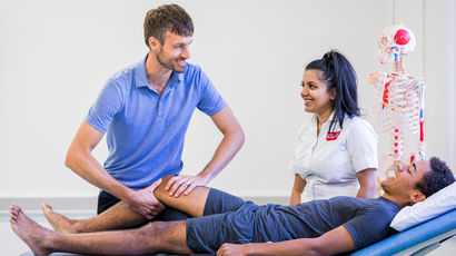 Patient having physio on his leg