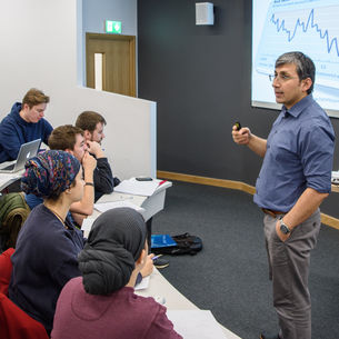 A lecturer teaching a group of students