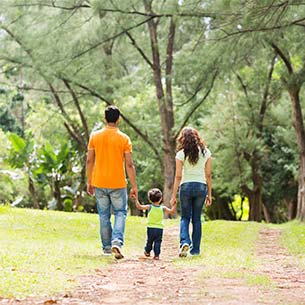 parents walking with their young child