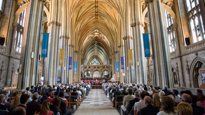 The crowd seated in Bristol Cathedral ready to watch an Awards Ceremony.