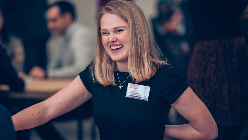 A female student smiles at the celebrating UWE talent event