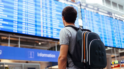 student at airport about to depart on his year abroad