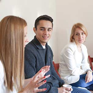 Three students in a group discussion