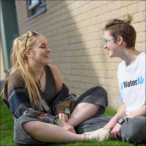Two students talking outside student accommodation