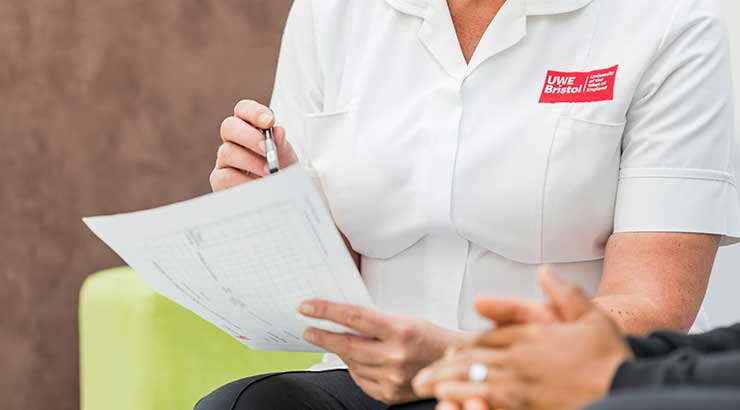 Close up of student nurse holding a document