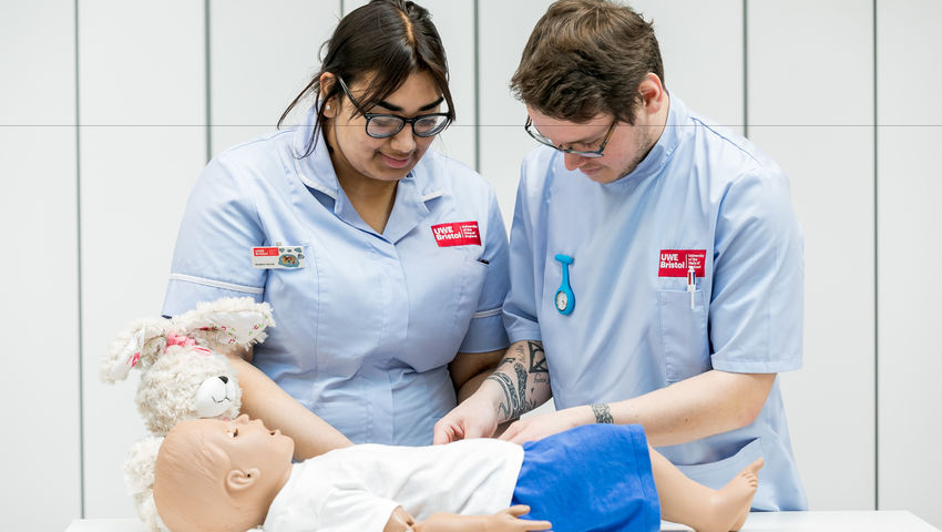 Nursing students with a dummy in the Skills Simulation Suite on Glenside Campus.