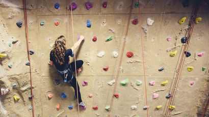 The climbing wall at the Centre for Sport in use.