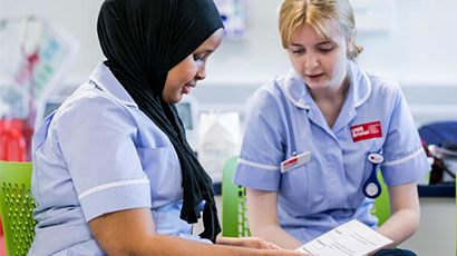 Nursing students filling in form