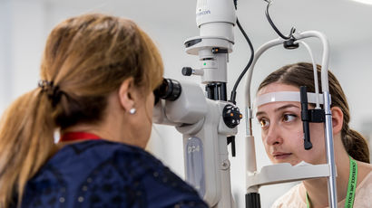 Woman having eye examination.