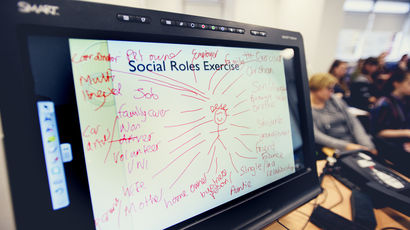 White board demonstrating a social roles exercise of who we come into contact with every day