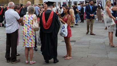 Graduates and their family photographed outside Bristol Cathedral