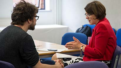 Student having a one-on-one conversation with a UWE Bristol staff member