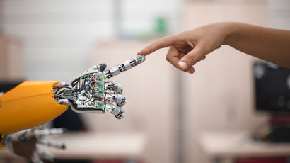 Robotic arm touching a human's hand.
