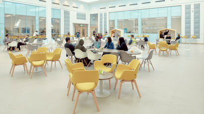 People sitting at tables in the Enterprise Zone.