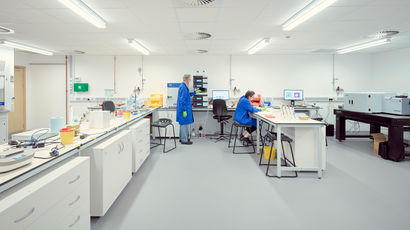 Two people working in a lab.