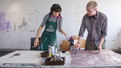 Student artists in a studio.