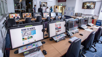 Computers in a computer lab with different software on their screens